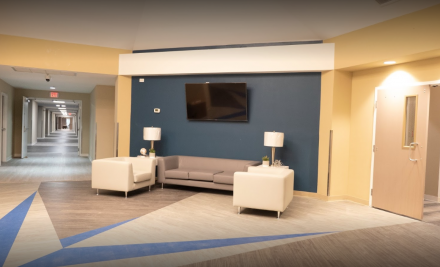 Main entryway with a seating area and television